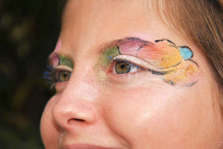 eyeshades: girl with face painted for carnival and halloween