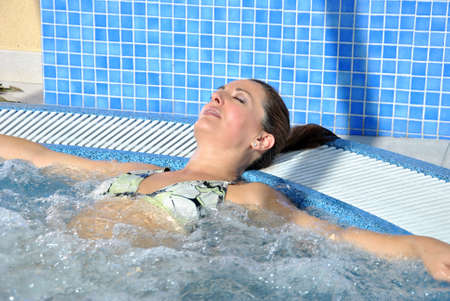 completely: woman in a jacuzzi completely relaxed and enjoying the water