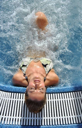 woman in a hot tub completely relaxed and enjoying the water