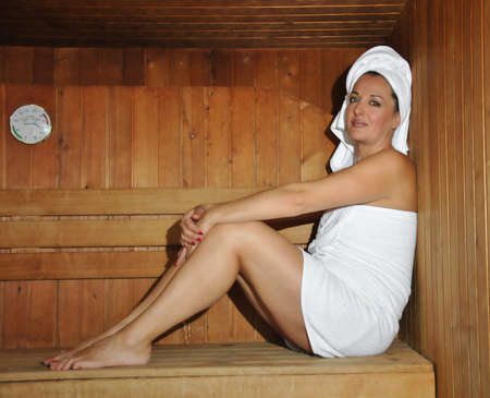 woman relaxing in a sauna with the heat