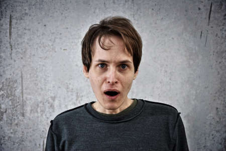 exult: Crazy young man with surprised face Stock Photo