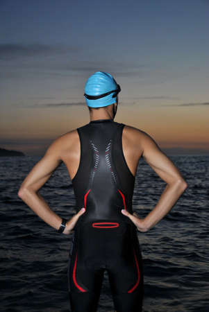 young athlete triathlon in front of a sunrise over the sea Stock Photo