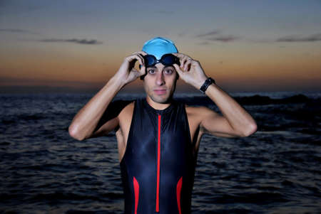 triathlon young athlete out of the sea at dawn Stock Photo