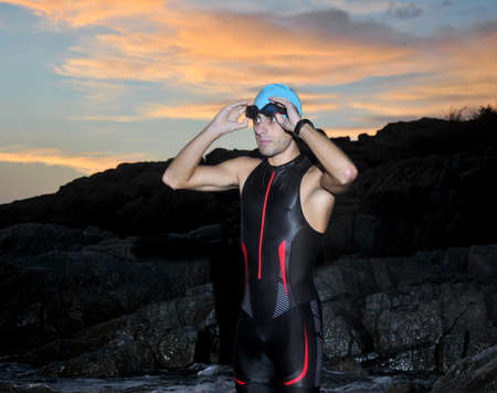triathlon young athlete out of the sea at dawn Standard-Bild