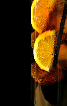 glass with drink coke ice and lemons