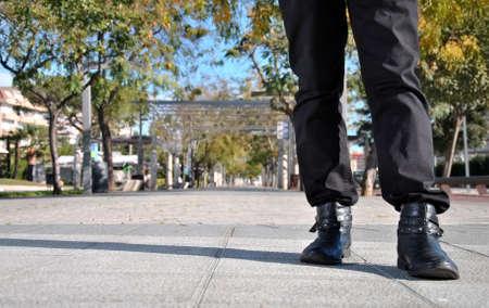 legs around: legs of young man walking around town