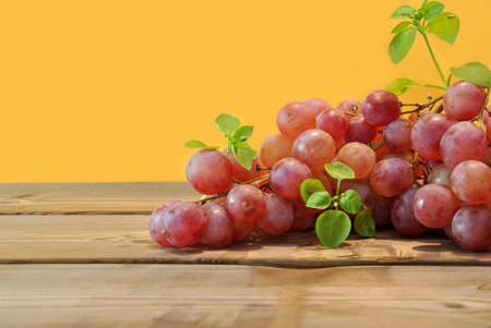 bunch of red grapes on wooden board photo