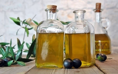 cooking oil: bottled olive oil in small glass jars