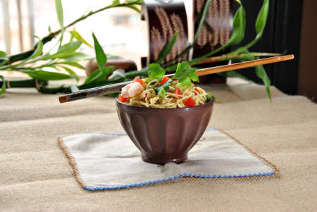 Chinese noodle dish with shrimp and vegetables photo