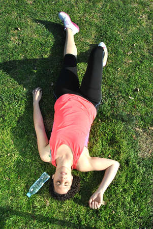 athlete tired and lying on the grass photo