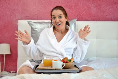 Woman shocked by having breakfast in bed photo