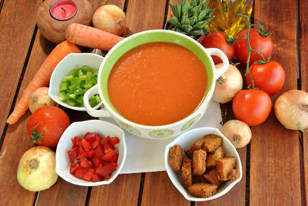bowl of gazpacho with tomatoes, oil and various vegetables Stock Photo