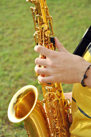 african sax: modern musician posing with his saxophone in the garden Stock Photo