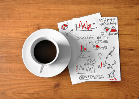 coffee with digital tablet and analytical paper business photo