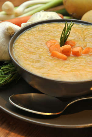 accompanied: vegetable soup accompanied carrot, potatoes and garlic Stock Photo