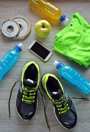 isotonic: Clothes make running with isotonic drink, phone and T-shirt Stock Photo