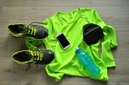 sports clothing: Clothes make running with isotonic drink, phone and T-shirt Stock Photo