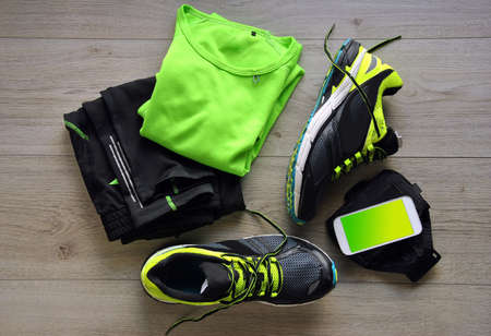 Clothes make running with isotonic drink, phone and T-shirt Stock Photo