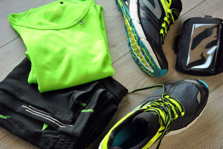 sport background: Clothes make running with isotonic drink, phone and T-shirt Stock Photo