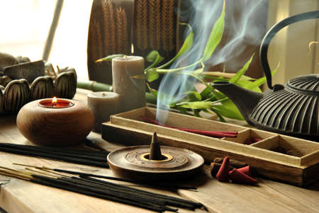 VARIOUS TYPES OF INCENSE WITH TEAPOT AND BUDDHA STATUE Stock fotó