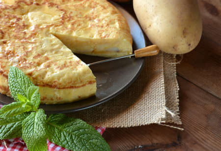 accompanied: Spanish omelette with potato and egg, accompanied by olive oil Stock Photo