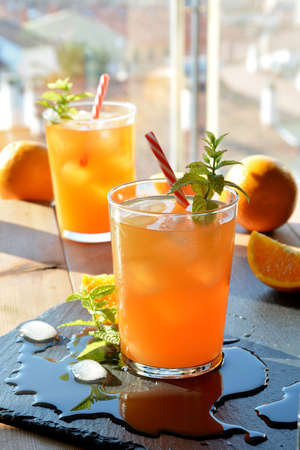 refreshing drink orange and mint with a little vodka Standard-Bild