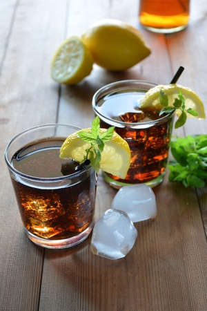 two glasses of Cuba Libre cocktail with lemon and mint