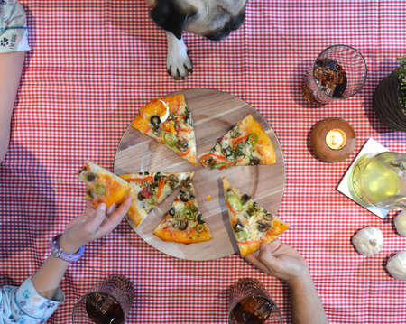 people   lifestyle: aerial view of family eating pizza at home