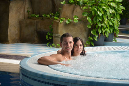 couple in love in hot tub enjoying a hydrotherapy session Stock Photo