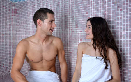 turkish bath: couple enjoying in a Turkish bath while they speak relaxed