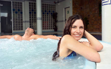 hydrotherapy: couple in love in jacuzzi enjoying a hydrotherapy session Stock Photo