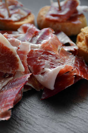 ham: appetizer of ham Serrano with bread roasted and accompanied by a glass of wine