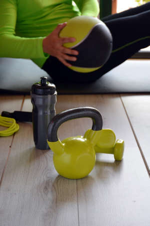 man training with kettlebell and medicine ball at home