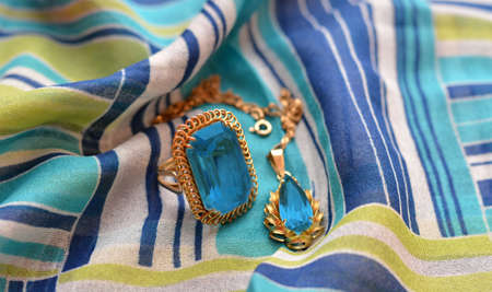 precious stone: ring and necklace golden accompanied by a precious stone