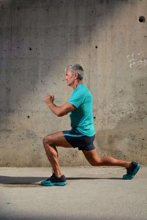 Elderly man practicing sports on the street Stock Photo