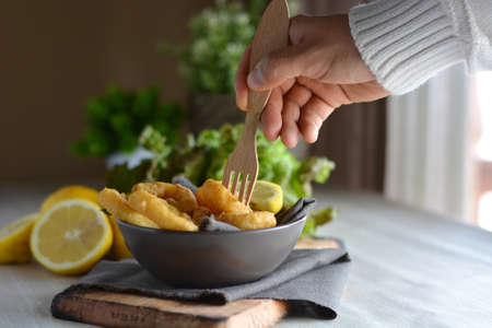 calamares:  Spanish cuisine. Dish with Fried Calamari accompanied by lemon Stock Photo