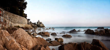 landscape sea of the Costa Brava with rocks and waves and long exposure