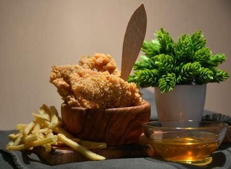 fried chicken platter accompanied by honey