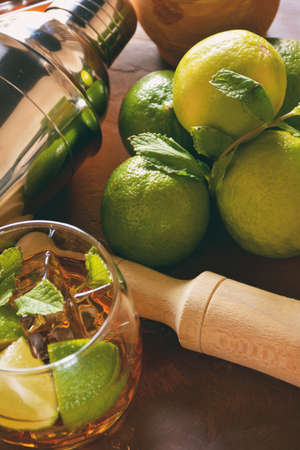 Ingredients for the realization of a mojito. We find limes, mint, rum, sugar and ice