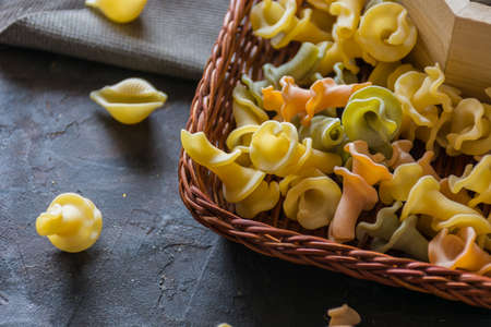 mediterranean diet: Typical Italian conchiglie pasta accompanied by macaroons Stock Photo