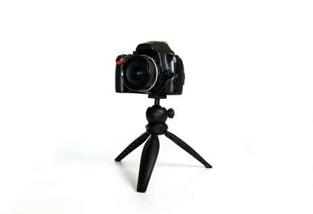 kleine statief voor fotografen en video met de mobiele telefoon en met een reflexcamera Stockfoto