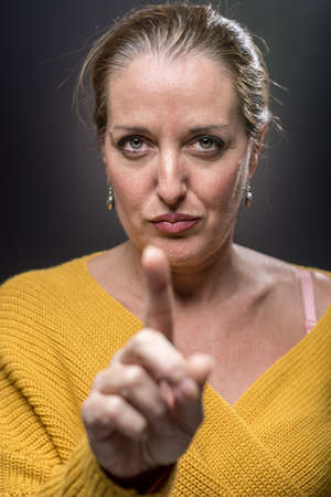 Portrait of 40-year-old woman with different emotions in his face Stock Photo