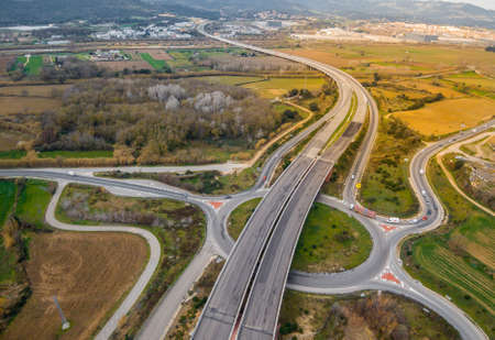 Photography aerial of a highways with little traffic on a cloudy day