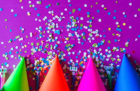 birthday celebration with paper hats, confetti, candles and party blowers