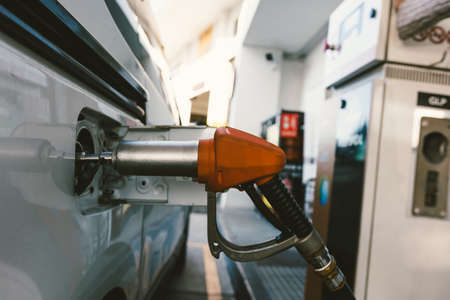 Ecological car that runs on natural gas. Hose to refuel the ecological vehicle