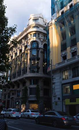 Old buildings of the Gran Vía de Madrid at sunset