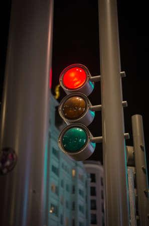 modern traffic lights on Gran Via de Madrid at night