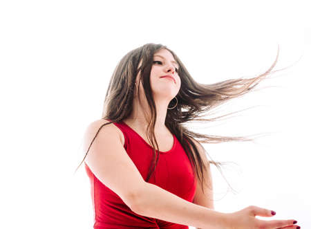 17-year-old teenage girl moving her hair freely over white background Stockfoto - 129829538