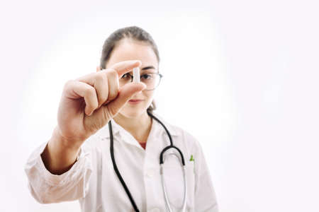 Doctor prescribing a headache medication. Photography on white background