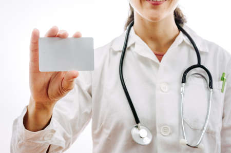 Doctor showing a blank health insurance card. Photo with white background ideal for adding text. Stock Photo
